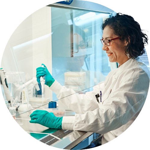 Professional lab technician analyzing probiotics